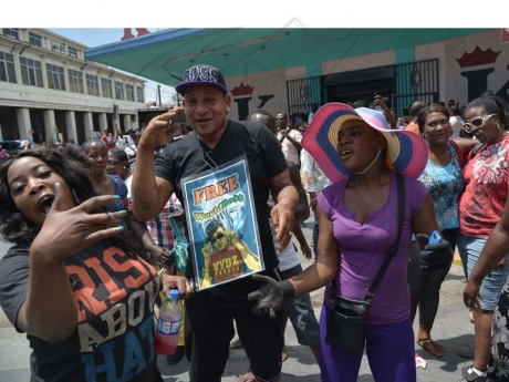 Kartel's Supporters outside the court... Vybz Kartel murder trial ,Photo by Jermain Barnaby