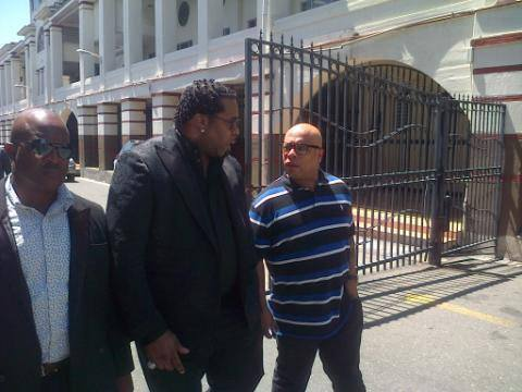 """rapper Busta Rthymes making an appearance at the Vybz Kartel murder trial to support the Dancehall artiste. The rapper told journalist outside the courthouse before going in - """"mi a talk after it done"""""""